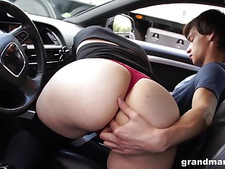 Age-old woman sucks young cock in the car and gets the brush pussy licked in public