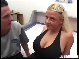 Busty mature wife gives a titjob and gets fucked on the bed