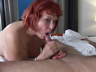 Red haired granny, Angie Summers is having hardcore sex with a younger guy from make an issue of neighborhood