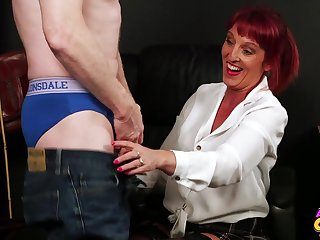 Redheaded Beau Diamonds sucks off a lucky guy and jerks him off